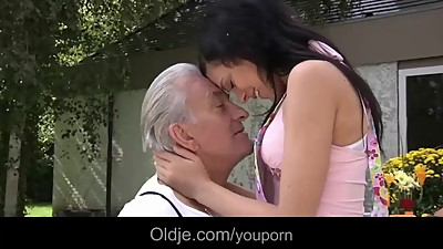 Old man and young girls enjoy a nice..