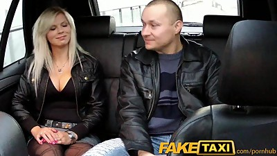 FakeTaxi Big tits blonde fucks partner..