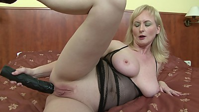 Blonde slut blows a long black dong..