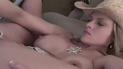 Insatiable Cowgirl masturbating