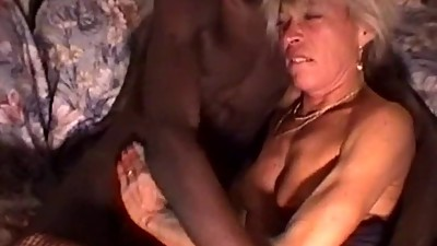 Mature blonde does interracial with..