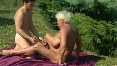 Granny fucks outdoors