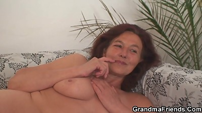 Grandma enjoys two young cocks