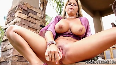 Milf stuffs her hot wet pussy under..