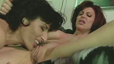 Two Milf's making out in the sofa