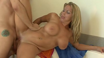busty blonde milf rides a cock