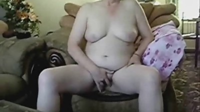 Busty grandma masturbating in front of..