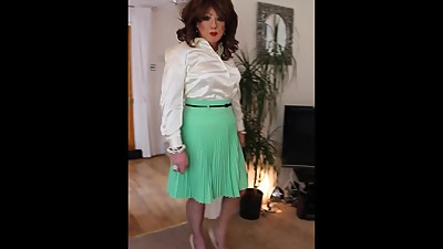 Mint green pleated skirt and cream..
