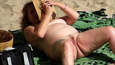 Nude Tattooed Mature At Beach