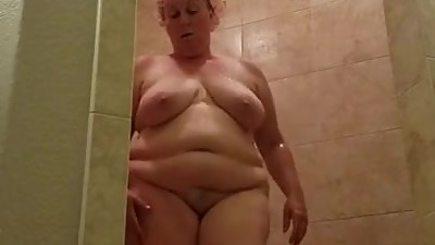 Plump busty mature shower voyeur