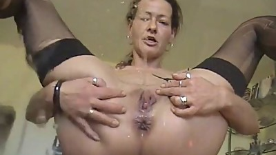 Brunette milf peeing on camera