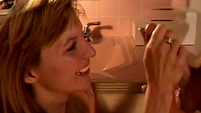 Bathroom facial for blonde MILF